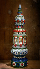 Ceramic statue - a tower with windows ornate patterns