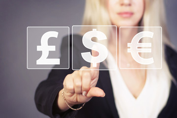 Businesswoman pushing web button with dollar icon virtual