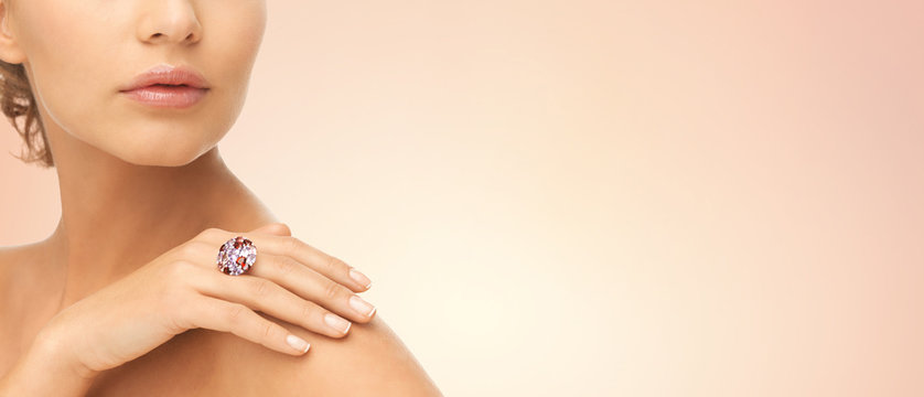 close up of woman with cocktail ring on hand