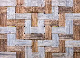Natural wooden wall is made by traditional bamboo wickerwork