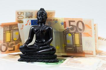 Buddha sorrounded by money