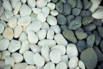 Background of black and white pebbles. Toned