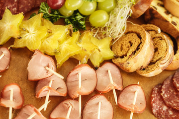 Catering service with various fruits and sausages