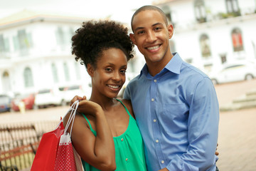 Portrait African American Couple Shopping In Panama City Smiling
