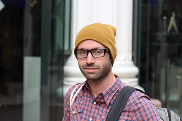 Portrait of Trendy Hipster Man in Funny Glasses and Winter Hat