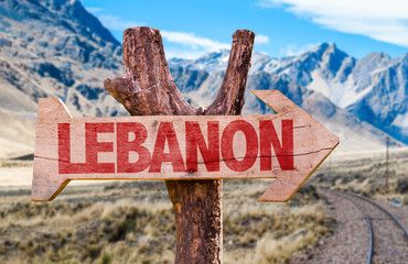 Lebanon wooden sign with desert road background