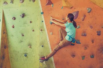 Active girl climbing indoor