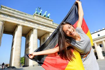 German flag woman happy at Berlin Germany
