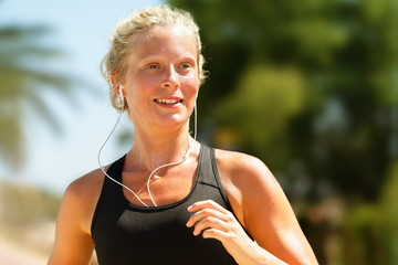 Running girl sweating workout with earphones