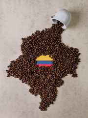 Fall cup coffee, coffee beans forming the map of Colombia