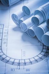 Composition of blueprint rolls construction concept