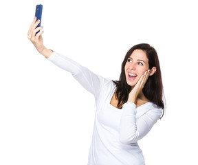 Woman take selfie on smart phone