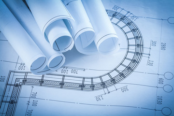 Rolls of construction blueprints building and architecture conce