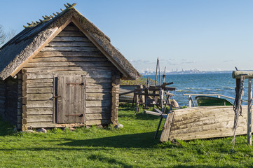 Rustic fisherman utility house and boats at sea coast, modern ci