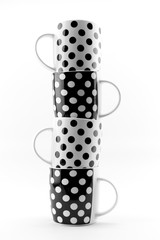 Black and white polka dots mugs isolated on white background