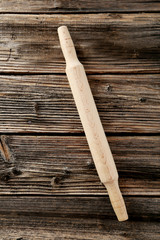 Rolling pin on brown wooden background