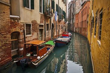 two boats in a narrow channel from venice