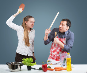 Working wife and househusband fighting in their kitchen