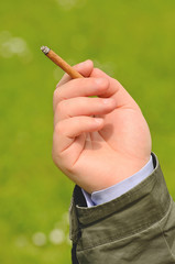 Male hand holding a cigarette