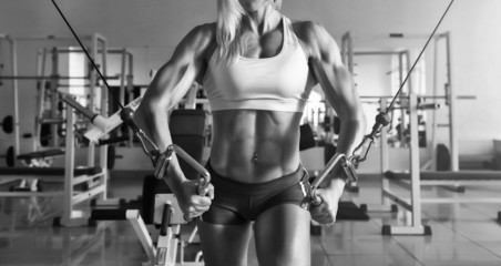 Strong woman doing exercise in the gym