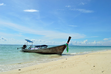 The wooden boat on a beach