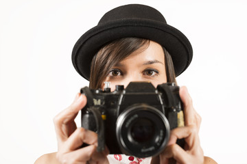 Pretty woman photographer with vintage camera taking picture