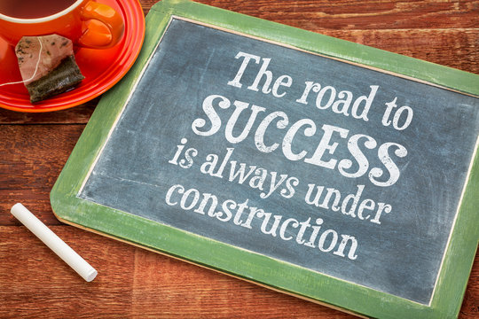 The road to success concept on blackboard