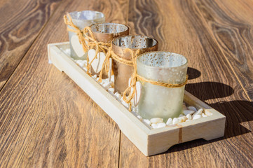 4 Candle holders in line