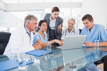 Team of doctors and businesswoman having a meeting