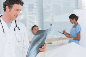 Doctor checking patients xray