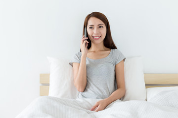 Woman talk to cellphone at bedroom