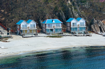 Wooden houses built on the coast.