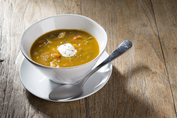 Vegetable soup on a wooden table