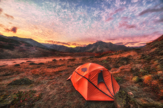 Camping at sunrise in the mountains