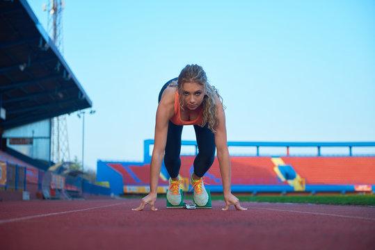 woman  sprinter leaving starting blocks