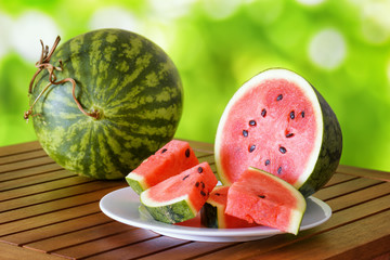 Fresh ripe red juicy watermelon on a wooden table