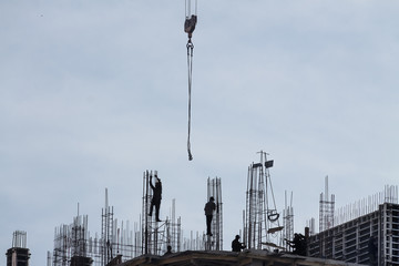 built structure workers on the roof, copy-space