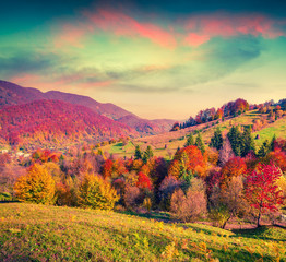 Wall Mural - Colorful autumn sunset in the mountain village