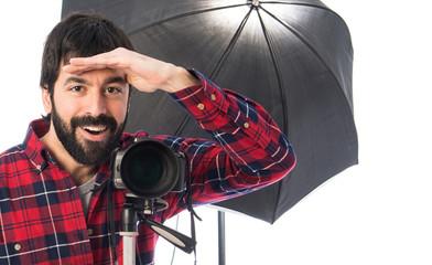 Photographer showing something