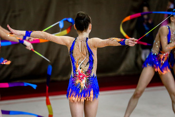 The girl gymnastics is back with gymnastic ribbon