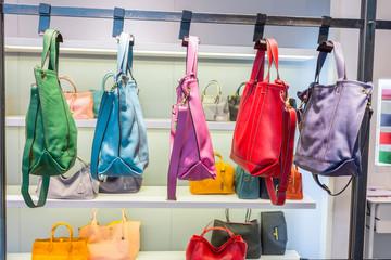 female bags in shop display window