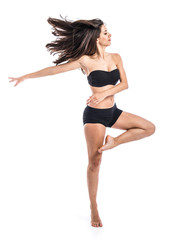 Young ballet dancer posing over white background