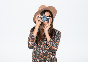 Woman photographing in studio