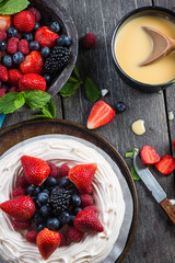 Homemade pavlova meringue with summer fresh berries