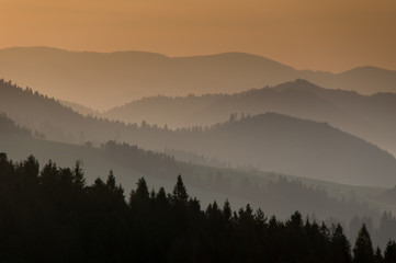 Morning mountain layers with forest on the foreground. Poland.