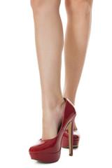 attraktive weibliche Beine mit roten Stilettos High Heels als Na