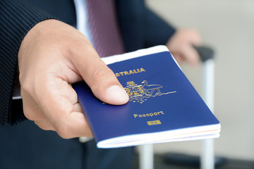 Hand giving passport - airport check in & security concept