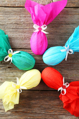Colorful easter eggs on grey wooden background