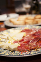 Spanish delicatessen: various types of cheese and ham