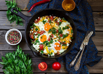 "Eggs poached with vegetables,named ""shakshouka"" ."